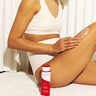 Woman applying Body Fit on her legs